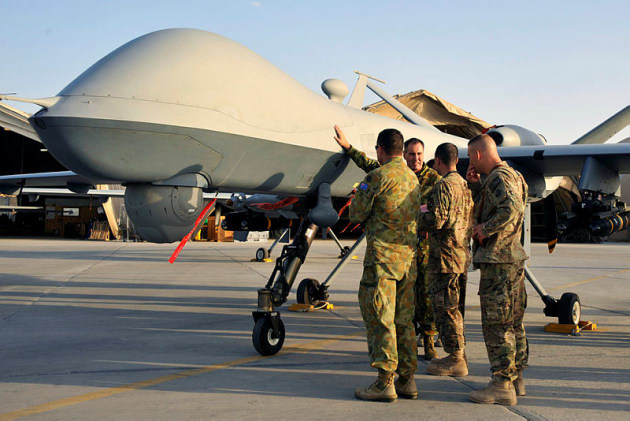 Chief of Air Force, Air Marshal Geoff Brown and party, are shown around a MQ-9 Reaper at Kandahar Airfield. Credit: Defence