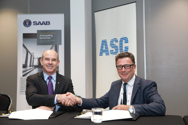 ASC CEO Stuart Whiley (R) and Saab Australia MD Andy Keough sign the agreement at the Submarine Institute of Australia conference in Canberra. Credit: ASC