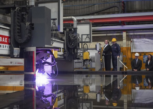 Minister for Defence Procurement Anne-Marie Trevelyan set the plasma cutting machine to work on a plate of steel. Credit: BAE Systems