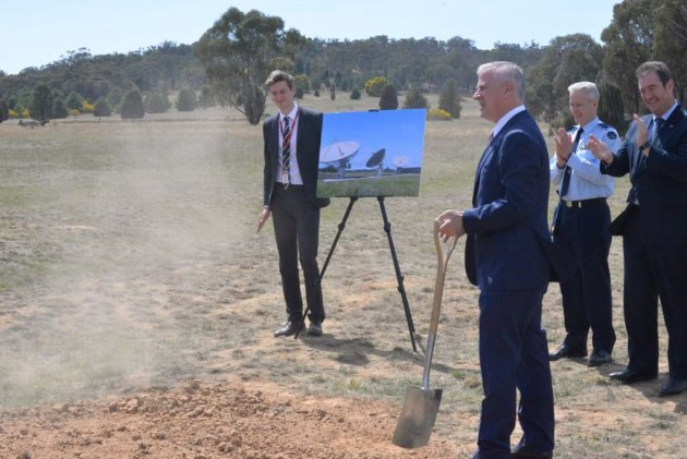 Deputy PM Michael McCormack turned the first soil for the construction of the satellite ground station.
