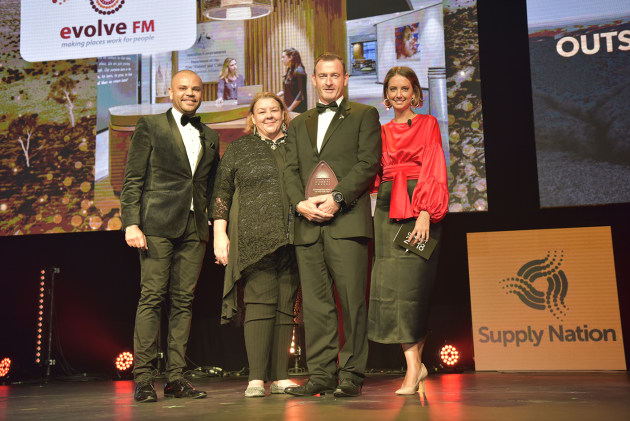 Evolve FM winning Registered Supplier of the Year. Luke Carroll, Steve Mackintosh (Evolve FM), Dave Macdonald (BP), Brooke Boney. Credit: Walter Quilliam