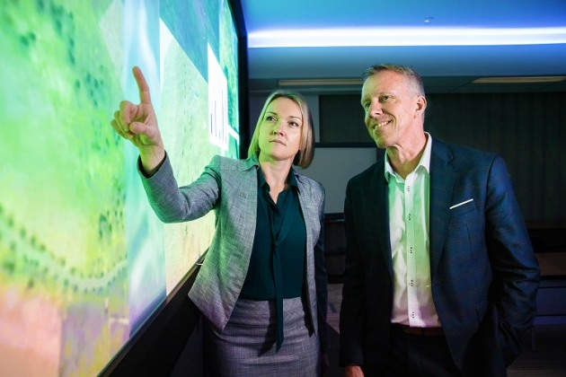 Emily Hughes, chief engineer for Boeing Phantom Works International discussing the AI project with Professor Jason Scholz, Trusted Autonomous Systems Defence Cooperative Research Centre. (Boeing)