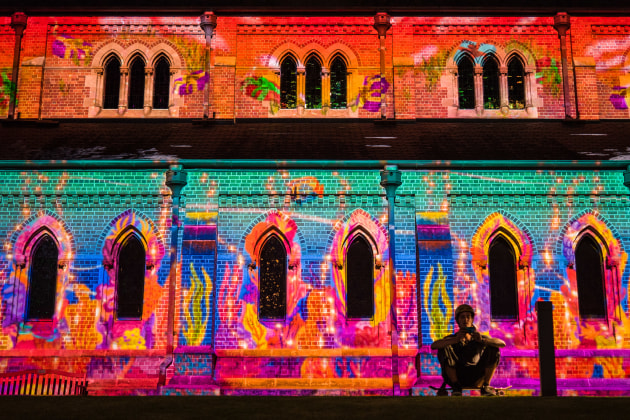 Christmas lights projected onto a church in Perth. The skateboarder using his phone is not obvious at first glance because of the 'in your face' bright saturated colours. LEICA CL, Summilux-TL 1:1.4/35 ASPH lens. 1/100s @ f1.4, ISO 1600.