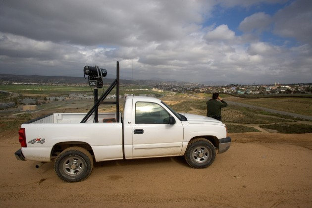 A US Border Patrol agent scans the Mexican border for signs of activity.