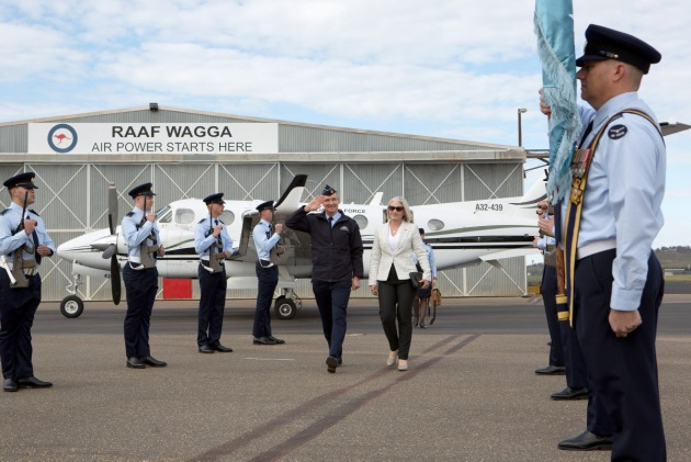 Chief of Air Force Air Marshal Mel Hupfeld and Lou Hupfeld pass through the Guard of Honour on their arrival to RAAF Base Wagga.