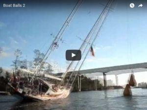 An oldie but a goodie - how to get a tall mast under a low bridge