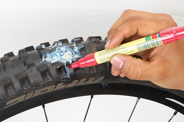 <p>Sometimes sealants struggle to repair smaller cuts. You may make it home without reinflating the tyre but the 2-3mm cut keeps opening up and weeping air and sealant whenever you ride. Start by locating the hole; easy to do if you've got reasonably fresh sealant inside. Use a marker pen or crayon to mark the spot.</p>