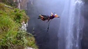 Check out this insane 600ft waterfall rope jump